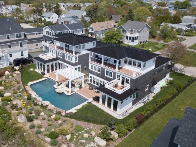 York, Maine oceanfront double mansion by Don Madore custom home design and construction. Saltwater pool.