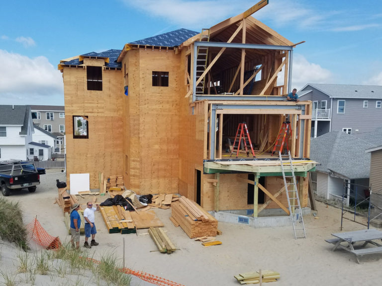 Under construction Hampton Beach, NH oceanfront home being built by Don Madore custom home design and construction. Serving New Hampshire, Maine and Massachusetts.